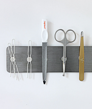 Mini magnetic strip holding small beauty and bathroom tools