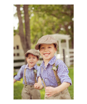 Two little boys wearing suspenders, baker-boy caps and gingham shirts