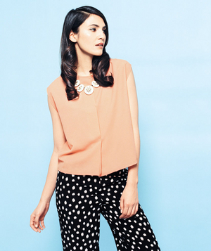 Model wearing black and white polka dot pants