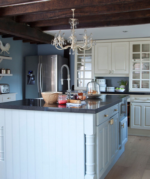 Chandelier in light blue kitchen