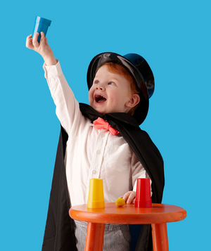 Birthday party guest performing a magic trick