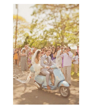 Newlywed's on vehicle after reception