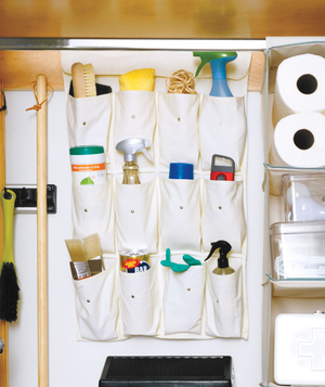 Hanging shoe organizer holding cleaning supplies