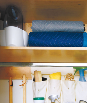 Humidifier and blankets on the top shelf of a closet