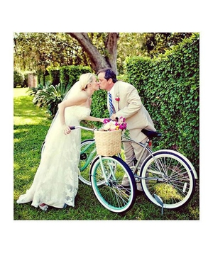 Newlyweds riding bicycles