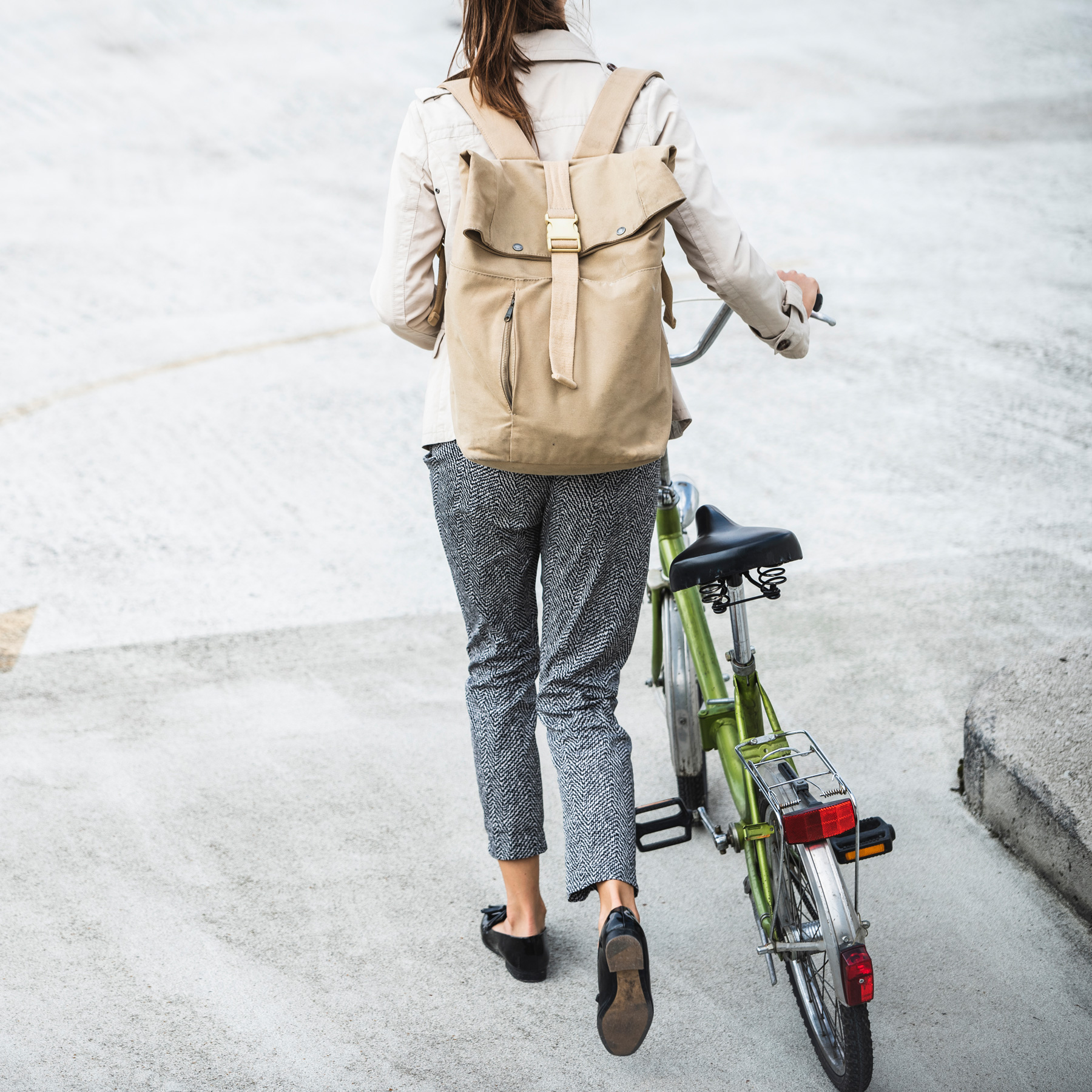 Ways to Be Healthy Every Day: woman commuting to work walking bicycle