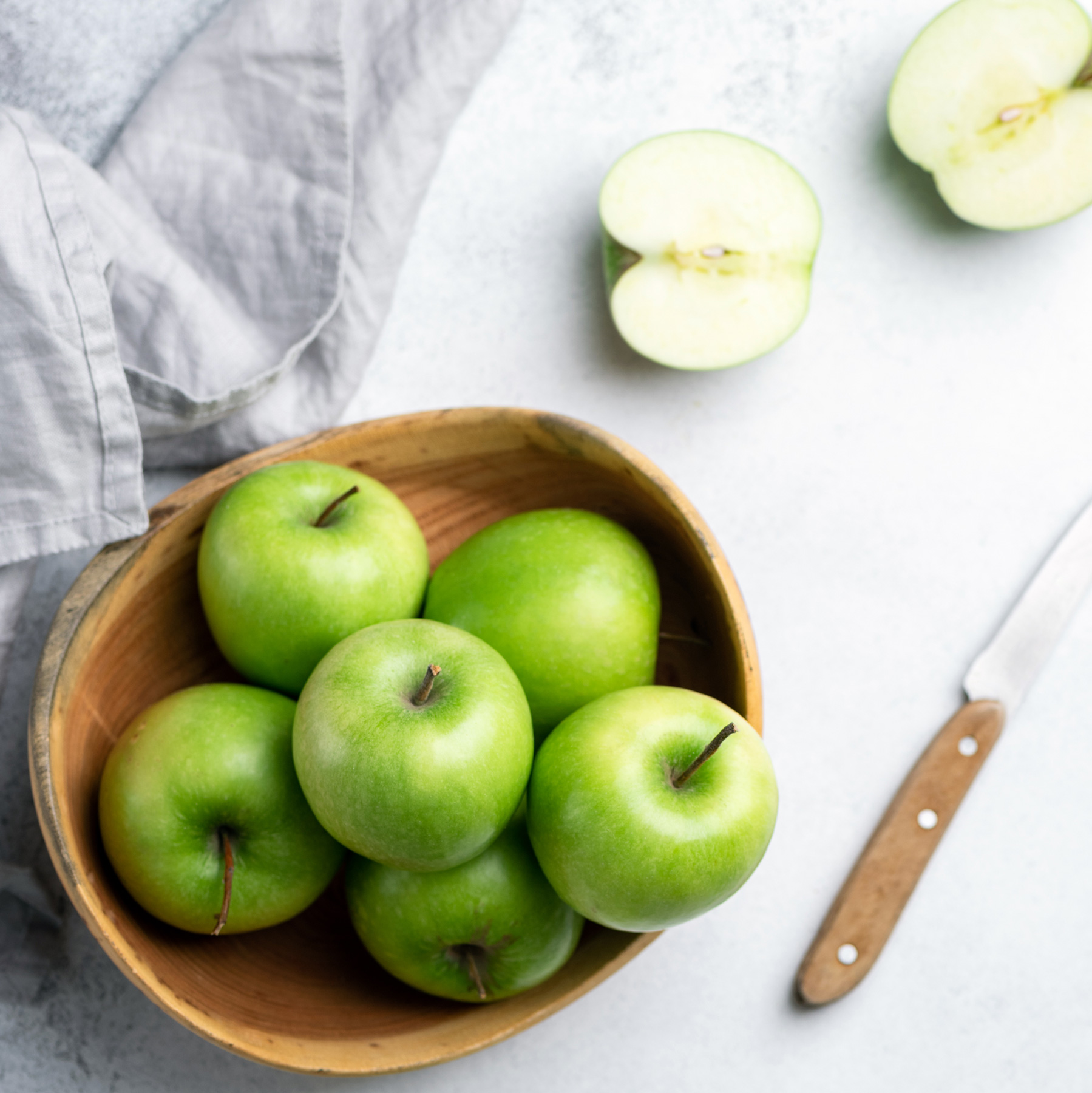 Ways to Be Healthy Every Day: Green apples in a wood bowl