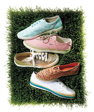 Printed and metallic sneakers on a patch of grass