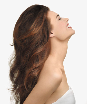 Model laughing with her head thrown back