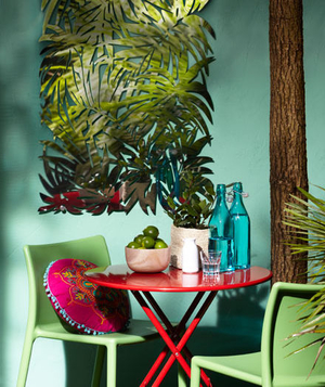 Red bistro table in a colorful outdoor dining area