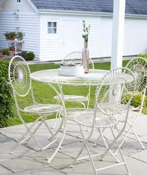 White metal dinette set outside