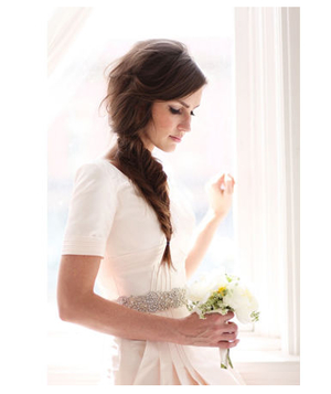Bride with a messy fishtail braid