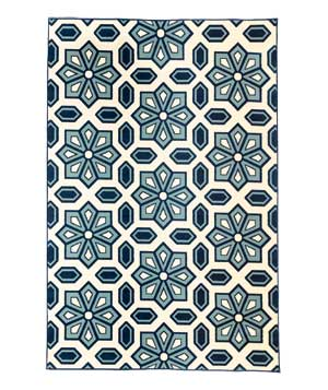 Blue and white patterned outdoor rug