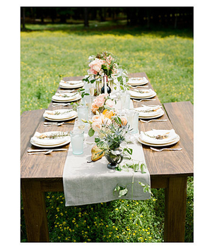 Exposed wood table setting for outdoor wedding