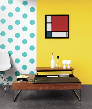 Convertible coffee table with bright walls and artwork