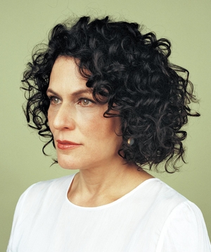 Woman with chin-length hair with defined curls