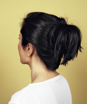 Woman with hair in twist and clipped in back