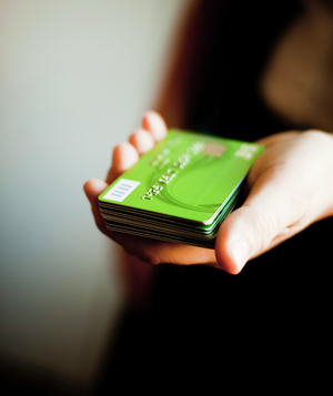 Hand holding out pile of credit cards