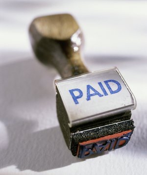 Rubber stamp that says PAID