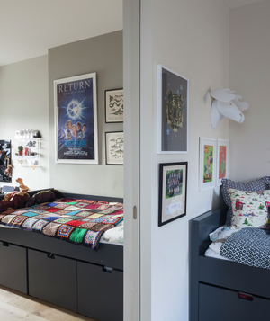 Two bedrooms separated by pocket door; beds have storage underneath