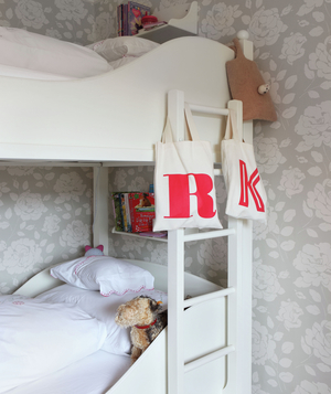 White bunk bed with white ladder and shelves