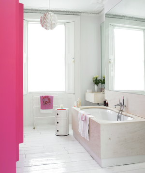 Bathroom with painted white floor, pendant lamp, and pink accents