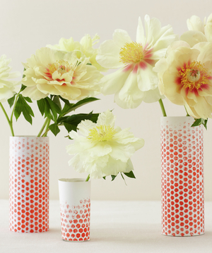 Centerpiece of flowers in red dotted vases