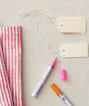 Patterned cloth napkins, paint pens, and office tags