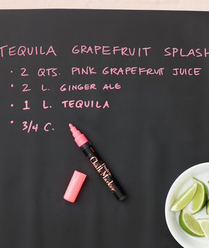 Black bar mat with pink paint pen and limes