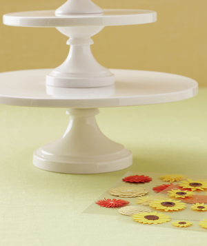 Orange and yellow floral stickers and a white cake stand