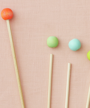 Painted wooden beads with skewers