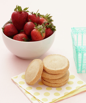 Strawberries, cookies, dotted napkins, extra baskets