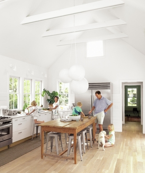 Kitchen with natural light, farm table, white paper lanterns