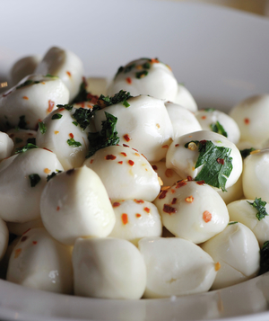 Bocconcini mozzarella with crushed red pepper and basil