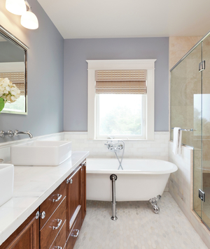 White and gray bathroom with large shower, hydrangeas