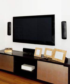 Entertainment center with built in speakers and television