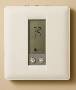 White thermostat on wall