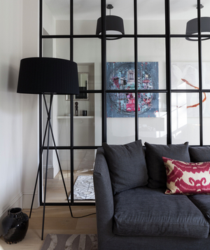 Room with black-paned glass divider