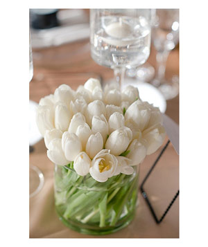 Wedding table with vase of white tulips