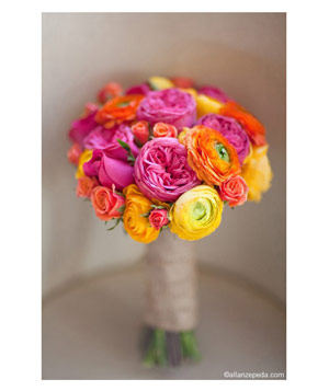 Bouquet of bright pink, orange, and yellow ranunculus