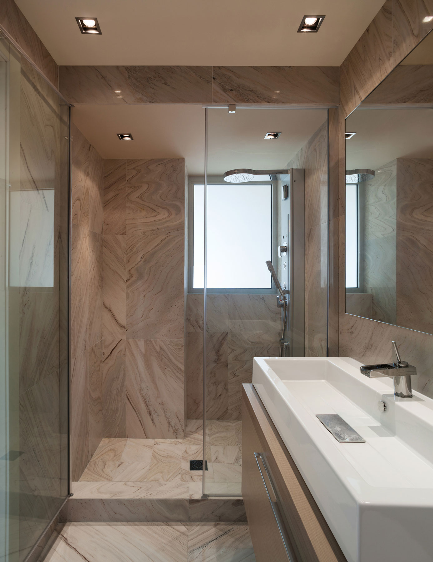 Bathroom with floor-to-ceiling marble tile