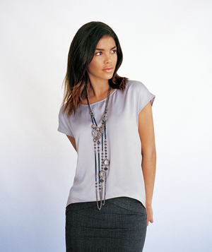 Model wearing lilac silk top with Simply Vera Wang necklace