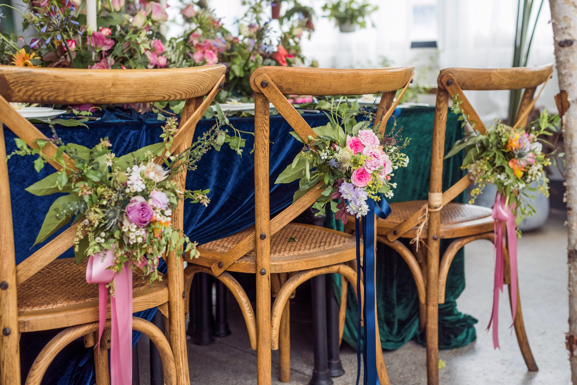 Rustic wedding reception chairs with flowers