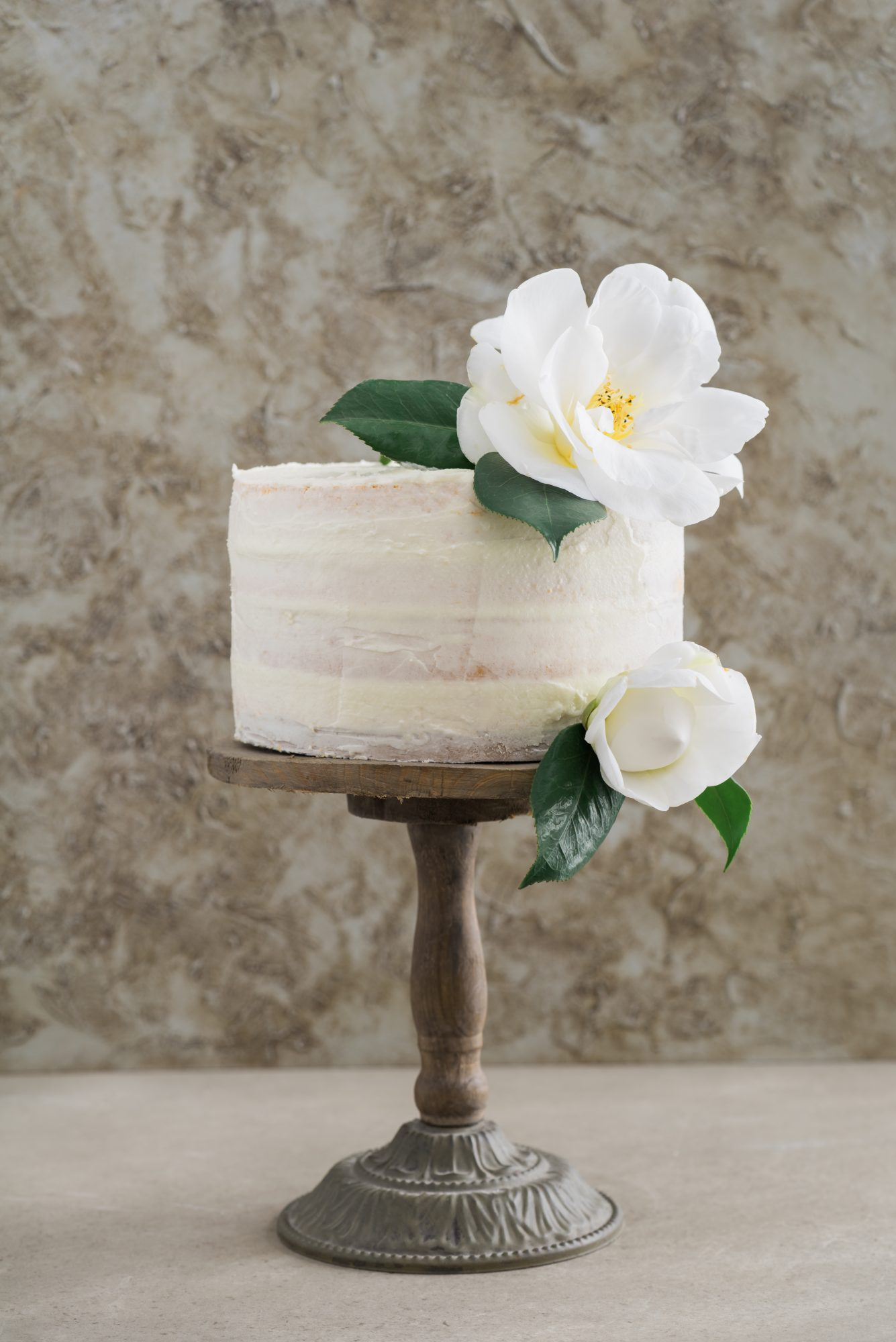 Simple white wedding cake with flowers