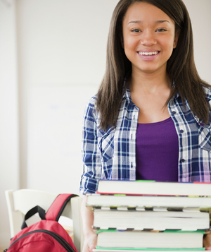 Student holding stack of books