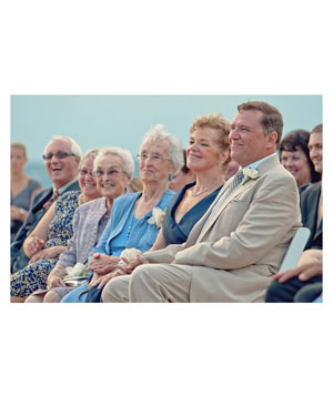 Family in first row at wedding