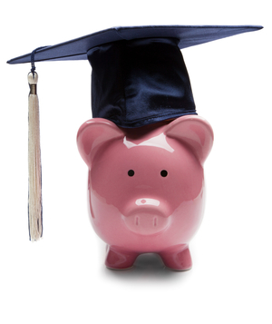 Pink piggy bank with graduation hat