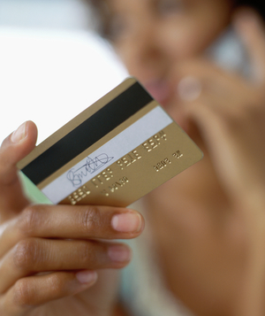 Woman on phone holding credit card