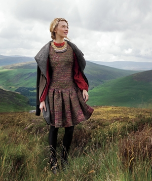 Model wearing tweed dress and wool coat