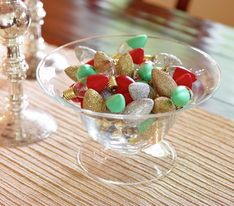 Glass bowl full of glittery holiday light bulbs